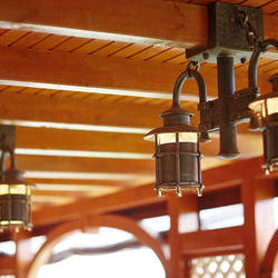 Wrought iron lighting in a summer house