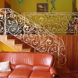 An exceptional interior staircase railing - A white railing with gold-green patina
