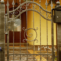 A wrought iron fence - rollmop pattern - An exclusive gate