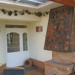 A wrought iron garden fireplace