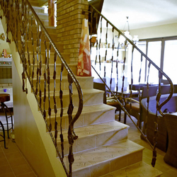 A wrought iron staircase railing