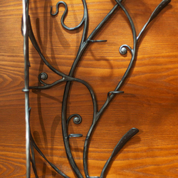 A hand wrought iron hanger - artistic furniture