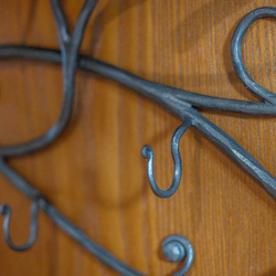 A hand wrought iron hanger
