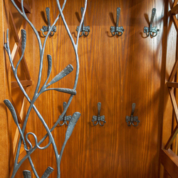 Wrought iron hangers - artistic furniture to the front