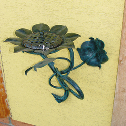A wrought iron ashtray - sunflower