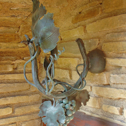 A vintage light - a hand forged lamp