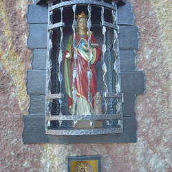 A wrough iron monument of st. Barbara with grille