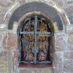 Forged monument of Saints - writing, grille, characteristic feature. The book Way of Love, Writing Ave Maria