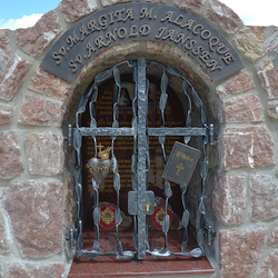 Forged monument of Saints, grille, writings, and characteristic features: Heart, Bible.
