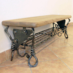 A hand wrought iron shoe rack of a unique design.
