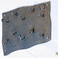 A hand wrought iron key holder