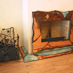 A copper wrought iron fireplace + a wrought iron firewood rack