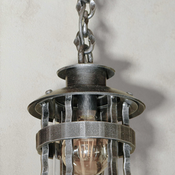 A wrought iron hanging light - Historical - a luxurious light