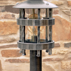 A wrought iron standard lamp Historical - a garden lamp