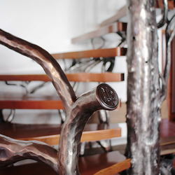 Detail of UKOVMI logo on a hand-forged interior railing