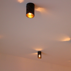 Modern ceiling lights in forged style - lighting of a family house interior