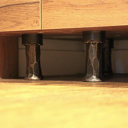 Forged furniture feet - kitchen cabinet in a family house