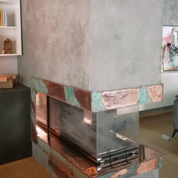 A copper wrought iron fireplace