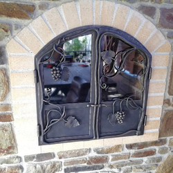 Hand-forged garden fireplace doors with grape motif