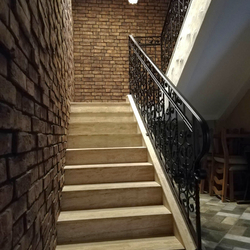 An interior staircase railing in an apartment hotel - luxury railings