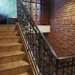 A luxury forged railing - staircase in an apartment hotel - interior railings