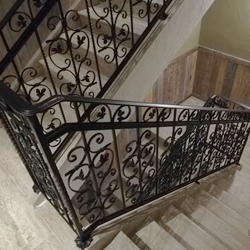 A wrought-iron multistorey railing - interior railing in an apartment hotel