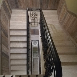 A multistorey interior railing in an apartment hotel - luxury wrought-iron railing from UKOVMI
