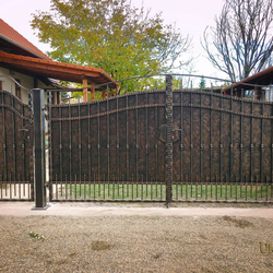 A full wrought iron gate - a cottage