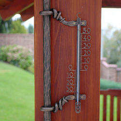 A wrought iron thermometer