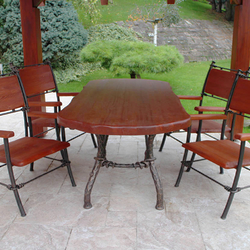 Wrought iron table and chairs - a garden furniture
