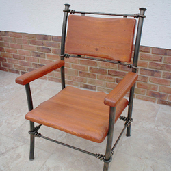 A wrought iron chair - A luxury chair