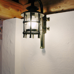 A hand wrought iron lamp in the summer kitchen - luxury lamp