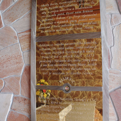 A golden plated board with a prayer in the brushed stainless steel frame in the pilgrimage place