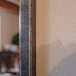 An industrial mirror in silver patina - a metallic mirror made by UKOVMI