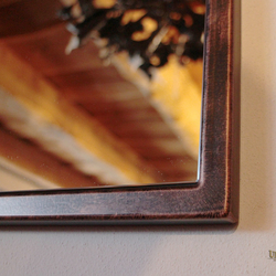 An industrial mirror with simple metallic frame in copper patina - mirrors by UKOVMI