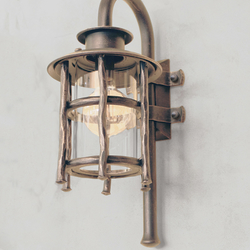 A wrought iron wall light Granny - exterior lamps