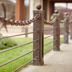 A modern wrought iron railing with a chain