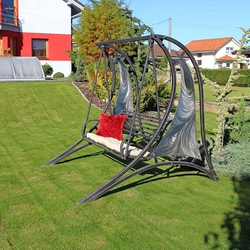 A modern wrought iron swing - a hint of futurism