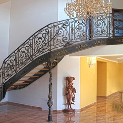 A wrought iron staircase with an exceptional interior railing