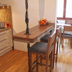 A wrought iron frame for a kitchen bar counter