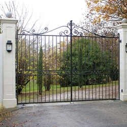 A wrought iron gate with underground drives openers - A luxury gate in France