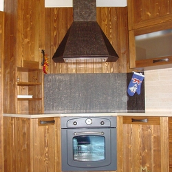 A kitchen wrought iron cooker hood