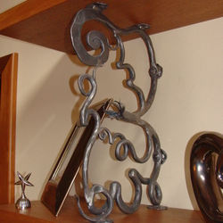 A wrought iron shelf