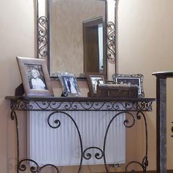 A wrought iron table with a mirror - luxury furniture