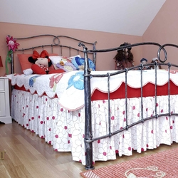 A wrought iron bed - a children's room - romantic forged furniture