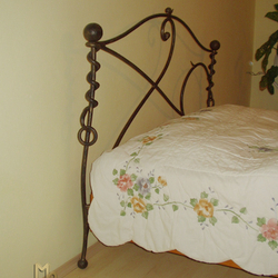 A wrought iron bed headboard