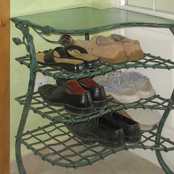 A wrought iron shoe-rack