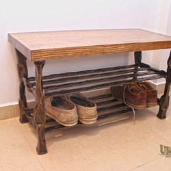 A wrought iron shoe-rack - luxury furniture