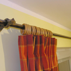 A wrought iron curtain rod - wrought iron furniture