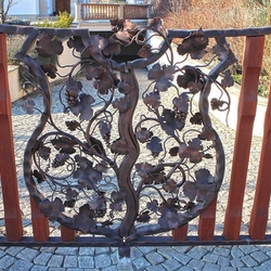 A gate - a vine in the coat of arms - A hand forged gate with a wood